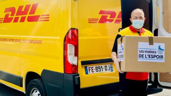 A DHL Worker carrying a Package in France