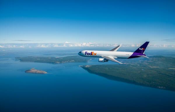 A FedEx Cargo Plane flying over an Archipelago