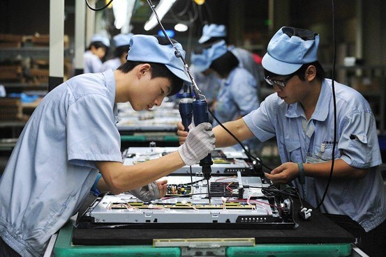 Workers Assembling a High Tech Product in a Chinese Factory