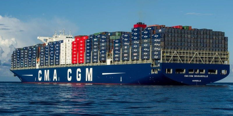 Sea vessels is loaded with huge number of containers.