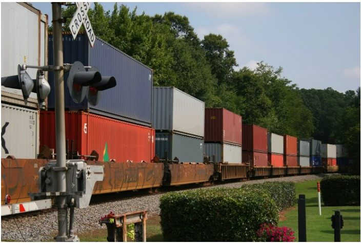 Freight Train Carrying Tonnes Of Goods And Moving Efficiently.