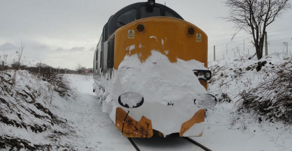 Freight Train Going On In Bad Weather Condition